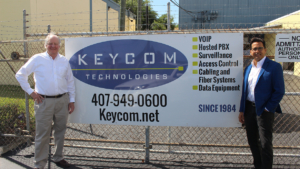 CEO XChange Program Manager Hal Thayer with KeyCom's Phil Medina